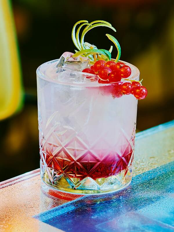 Miss Ko - Photograph of a red fruit cocktail in a tumbler glass