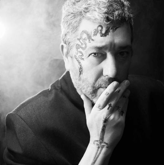 Miss Ko - Photograph of a tattooed man